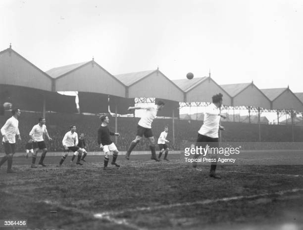 Players in a football match between Woolwich Arsenal and Fulham at Highbury London