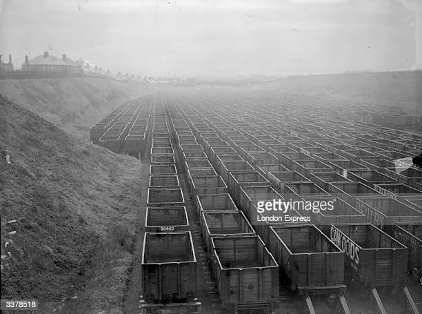 Empty coal trucks in a Cardiff siding S Wales