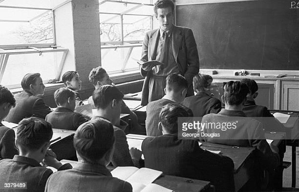 Teacher taking a class at Belmont Secondary Boys' School, Harrow Weald. Original Publication: Picture Post - 6442 - 3 000 Illiterates: Why? - pub....