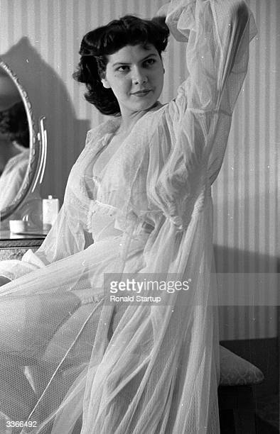 London model Barbara Whitburn in a nylon negligee She has been hired by a Yorkshire store to promote underwear by posing in their window for three...
