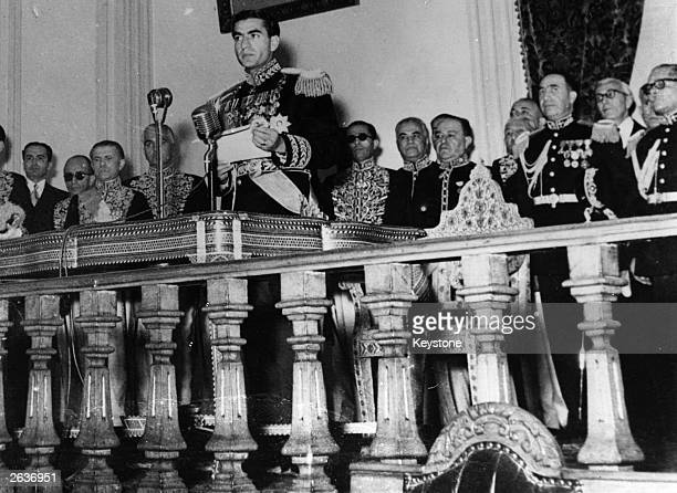 RezaPahlavi Sharpoor Mohammed the Shah of Persia making a statement regarding the AngloIranian Company's oil industry to the Senate