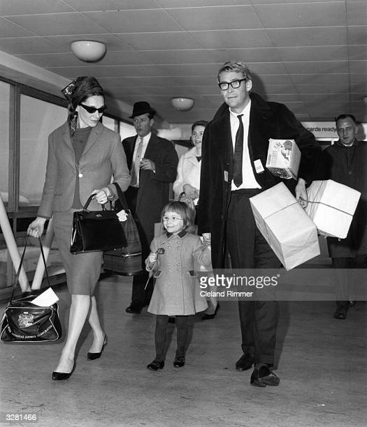 Welsh actress Sian Phillips arrivies at London Airport with her husband Peter O'Toole.