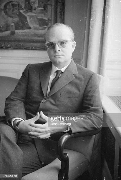 American novelist Truman Capote sits with his hands clasped