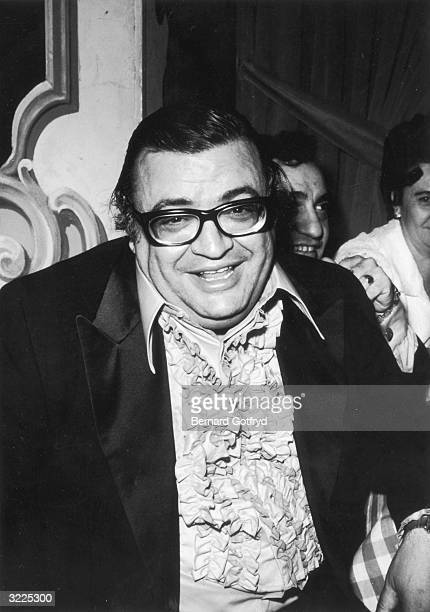 American author Mario Puzo smiles while sitting at a party in New York for director Francis Ford Coppola's film 'The Godfather' Puzo adapted his own...
