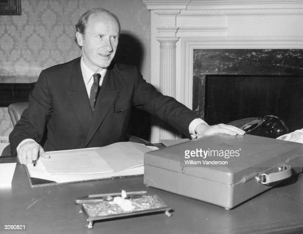 Chancellor of the Exchequer Anthony Barber at his desk at the Treasury with the famous red 'budget box' prior to his Budget Day announcements