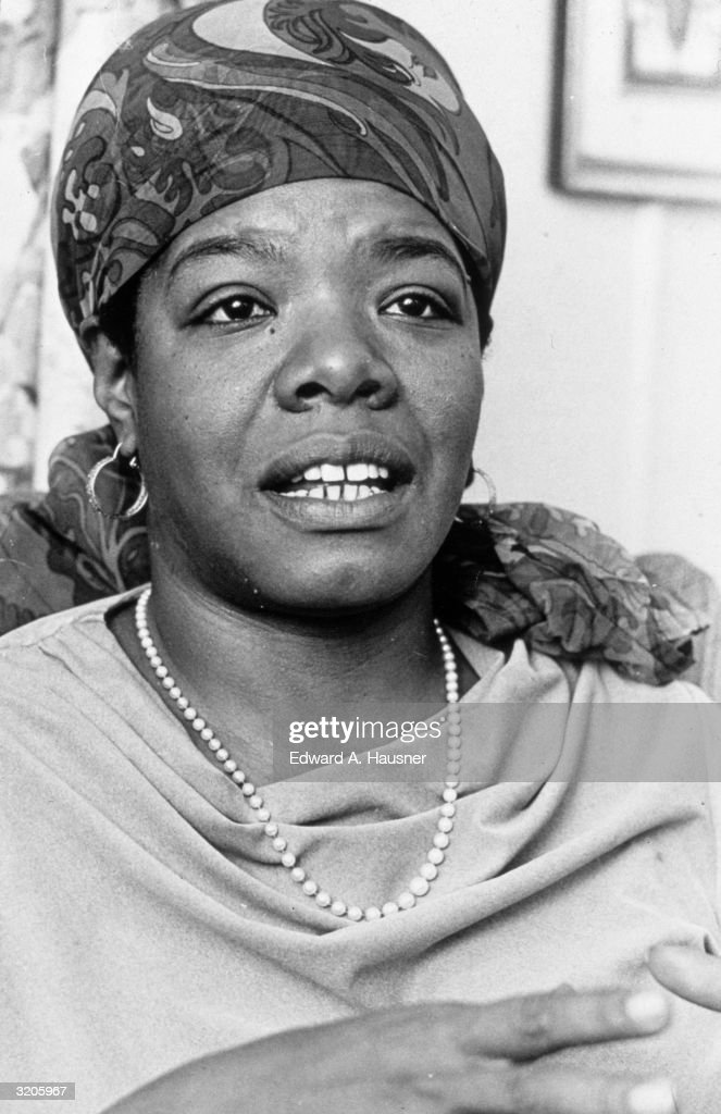 Headshot of American poet and author Maya Angelou talking at the Algonquin Hotel, New York City. She wears a scarf tied over her head and a pearl necklace.