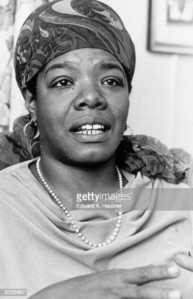 Headshot of American poet and author Maya Angelou talking at the Algonquin Hotel, New York City. She wears a scarf tied over her head and a pearl...