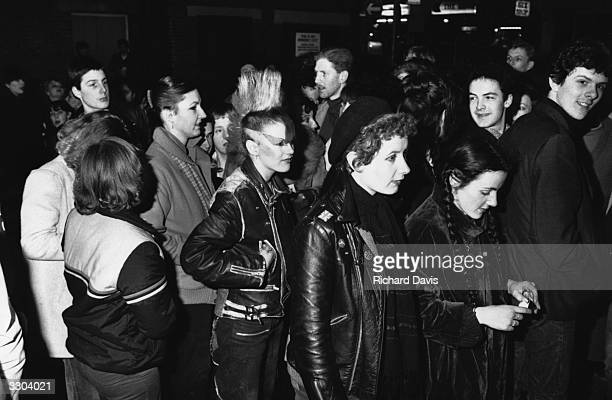 Punks in the queue outside the Prince Charles Theatre London for the opening night of the film 'Rude Boy'