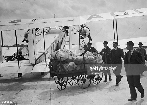 The first flying mail from Australia to England arrives at Croydon airport and is taken off for sorting after being unloaded