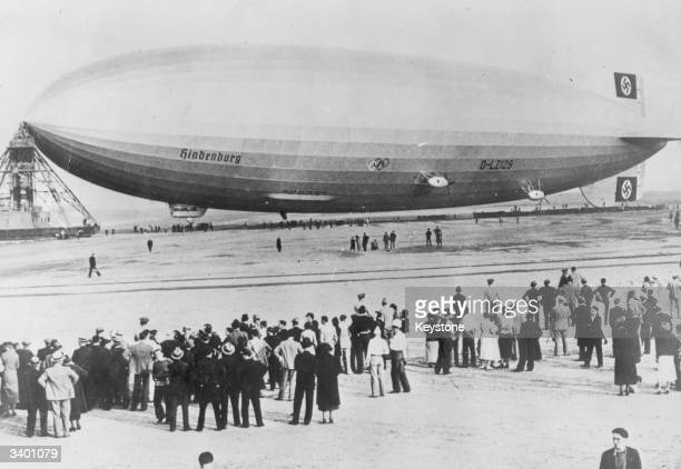 The German hydrogen filled airship Hindenburg The airship runs scheduled services between Friedrichshafen Germany and Lakehurst New Jersey America