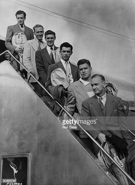 Members of the Australian Davis Cup team on the aircraft steps as they arrive at London Airport From the top Kenneth McGregor John Bromwich Frank...