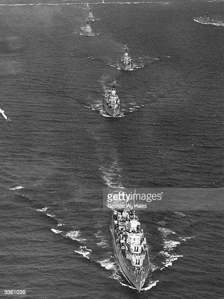 The Home Fleet escort led by HMS Vanguard following in the wake of the Royal Yacht Britannia after their rendezvous off Plymouth Hoe