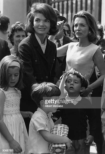 Jackie Kennedy on left widow of president John Kennedy with her children John Jr and Caroline and her sister Lee Radziwill with son Anthony outside...