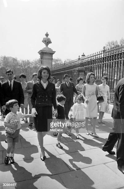 Jackie Kennedy widow of president John F Kennedy outside Buckingham Palace during a visit to London with her son John Jr her sister Lee Radziwill and...