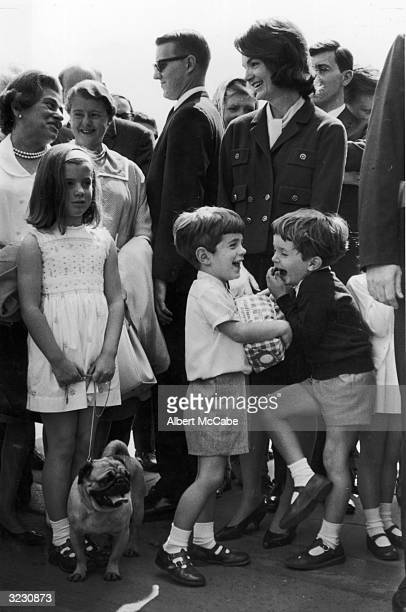 Jacqueline Bouvier Kennedy stands with her daughter Caroline her son John F Kennedy Jr and her nephew Anthony Radziwill outside Buckingham Palace as...