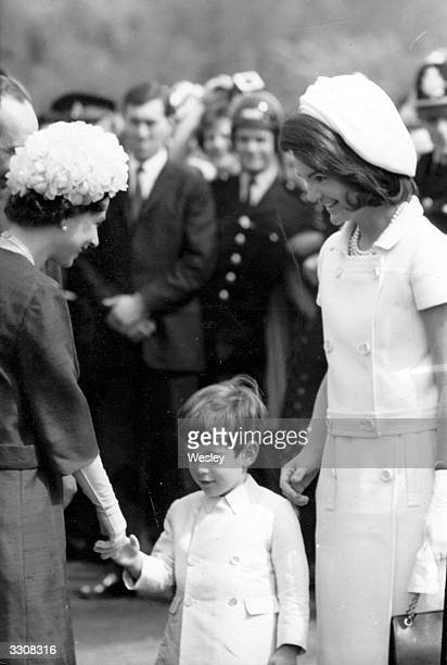 Queen Elizabeth II of Great Britain with John Kennedy Jr. , son of the late President John F Kennedy, and Jackie Kennedy during the inauguration of...