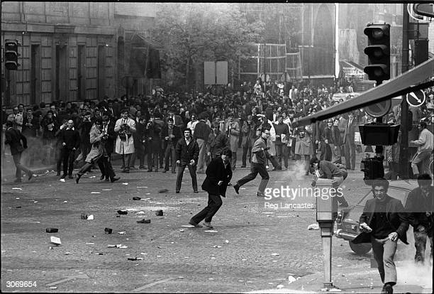 A street riot in Paris initiated by the students of the University of Paris in protest against police brutality WIthin days the unrest spread...