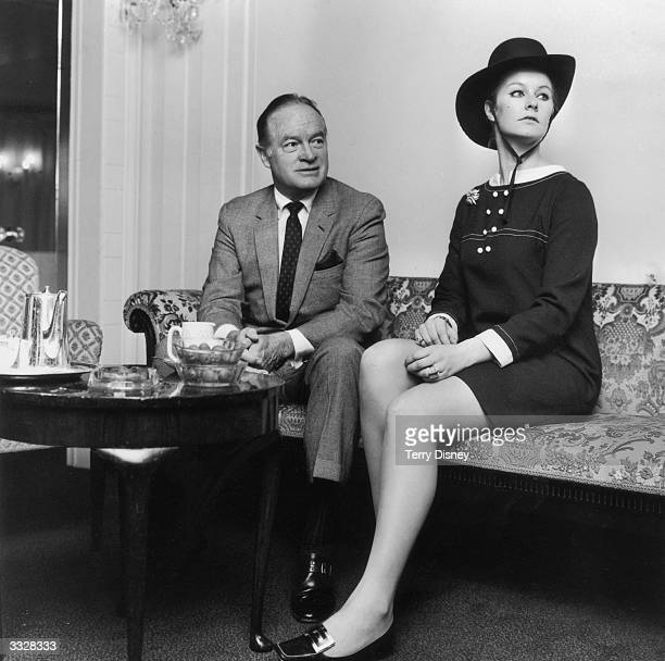 American singer, actor and comedian Bob Hope with his press officer Lady Carolyn Townshend at a Royal Variety Club lunch in London.