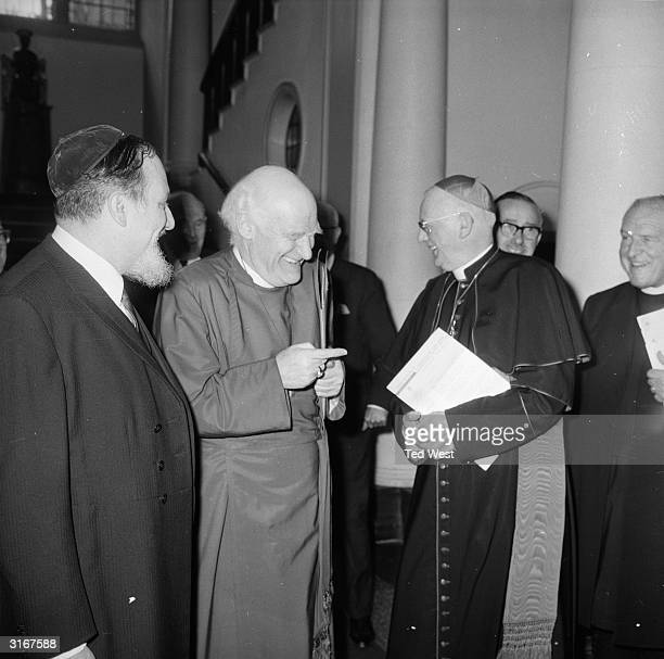 Sir Michael Ramsey the Archbishop of Canterbury shares a joke with the Roman Catholic Archbishop of Westminster Cardinal Heenan and the Chief Rabbi...