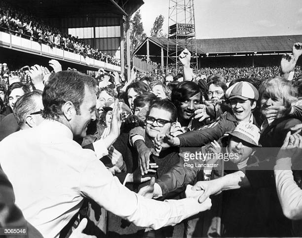 Fans greeting Queens Park Rangers manager Dave Sextonafter QPR had beaten Leeds 20 to go top of the league however ten days later Liverpool beat...