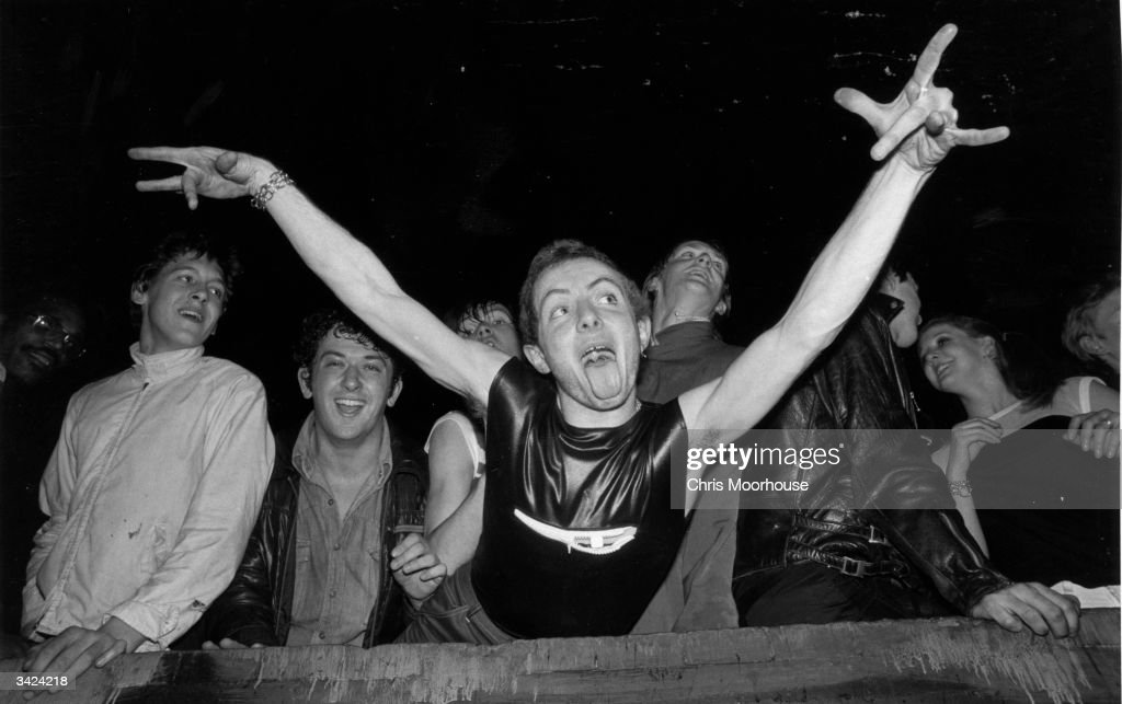 A punk 'spazzing' at the Rainbow Theatre in London while The Clash and The Jam play in concert.