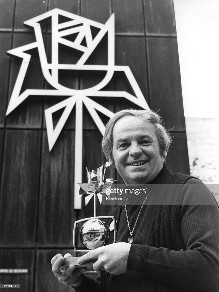 Francis Essex, director of production for ATV, with the Golden Rose of Montreux award, won by The Muppet Show.