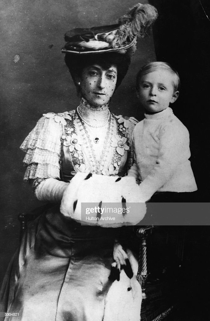 Queen Maud of Norway, (1869 - 1938), daughter of King Edward VII and Queen Alexandra, wife of King Haakon VII of Norway, elected King in 1905, with their son Crown Prince Olav, (1903 - 1991), at Windsor Castle.