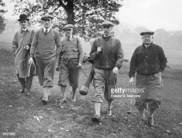 Arsenal FC soccer players and Manager Herbert Chapman playing golf Left to right Tom Parker Alec James and David Jack