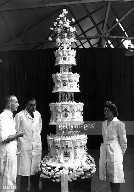 Mr Schur chief confectioner at McVitie and Price Ltd standing next to the official cake for Princess Elizabeth's marriage to Philip Mountbatten which...