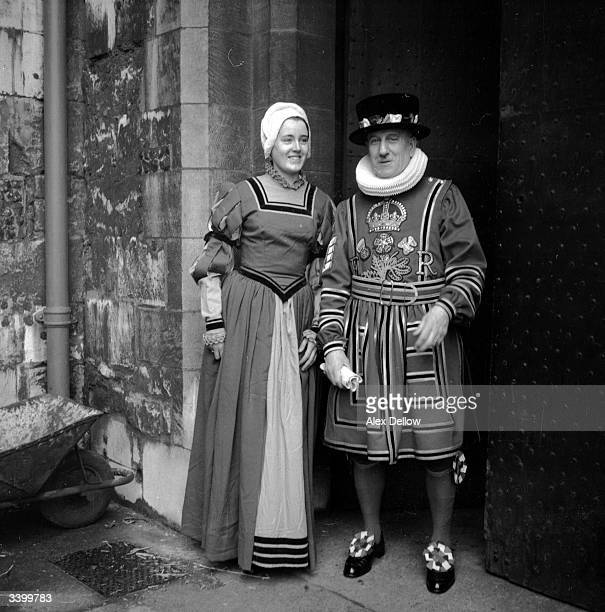 Two actors dressed in 1596style costumes as a lady and a beefeater for the filming of an Elizabethan television programme in London Original...