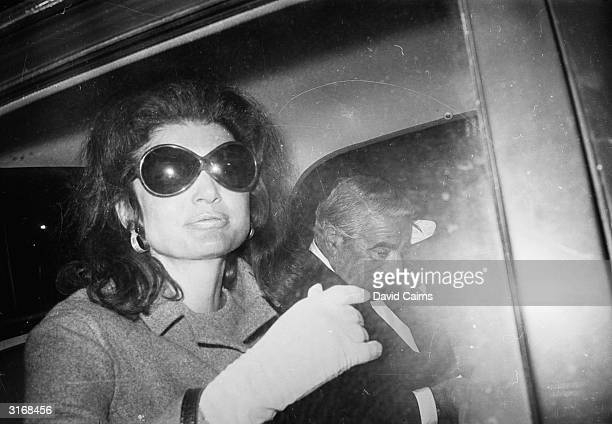 Greek shipping tycoon Aristotle Onassis with his new wife Jacqueline Onassis , the former wife of assassinated US president John F Kennedy, at London...