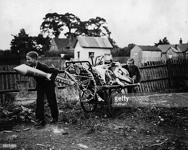 Two boys pulling a cartload of fireworks home in preparation for November 5th Guy Fawkes night