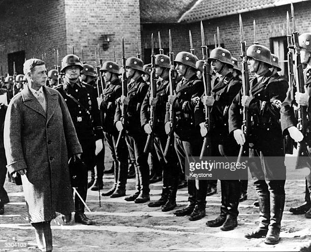 The Duke of Windsor inspecting a guard of honour on arrival at the Croessinsee Nazi training school during his visit to Germany