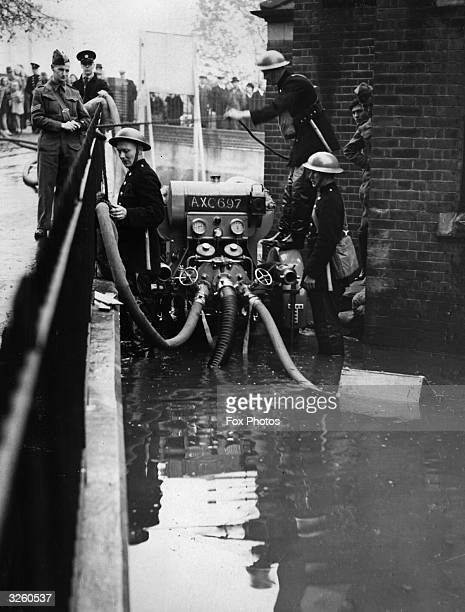ARP wardens use pumps on floods at River Ravenbourne in Catford