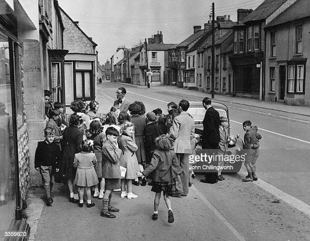 Children wait outside a Metholdist Church in Bicester Oxfordshire for their sunday school meeting Original Publication Picture Post 5137 Sunday...
