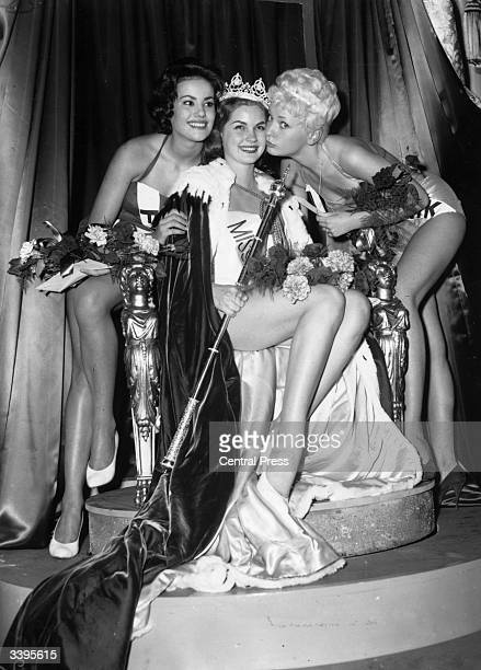 18yearold private secretary Penelope Anne Coelen representing South Africa is crowned Miss World 1958 With her are runnersup Claudine Auger of France...