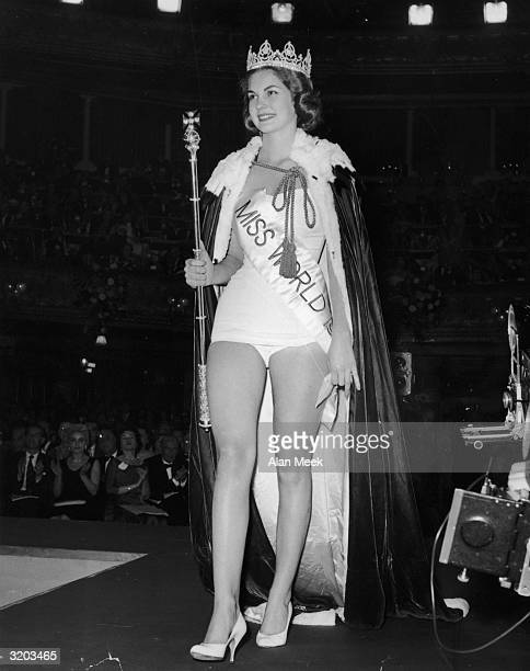Fulllength image of the winner of the Miss World beauty pageant Penelope Coelen Miss South Africa standing onstage in a swimsuit a crown and a cape...