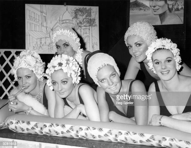 Davina Taylor, Ruth Dumer, Maureen Walker, Jacqueline Thorburn, Virginia Wonnacott and Carolyn Methven, modelling a range of swim caps for Kleinerts...