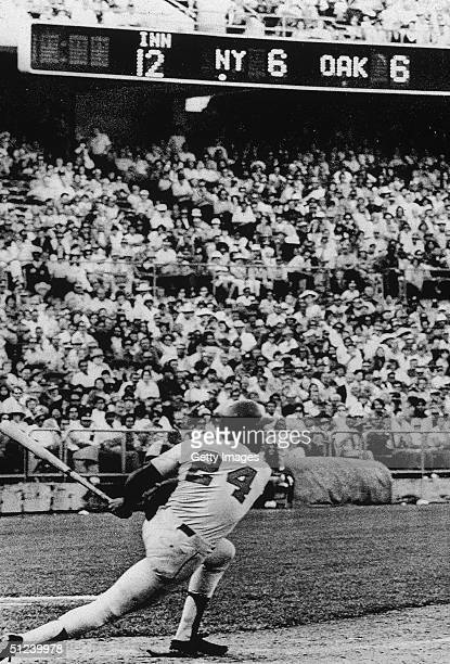 14th October 1973 American baseball player Willie Mays of the New York Mets hits a single over second base during the World Series Oakland California...