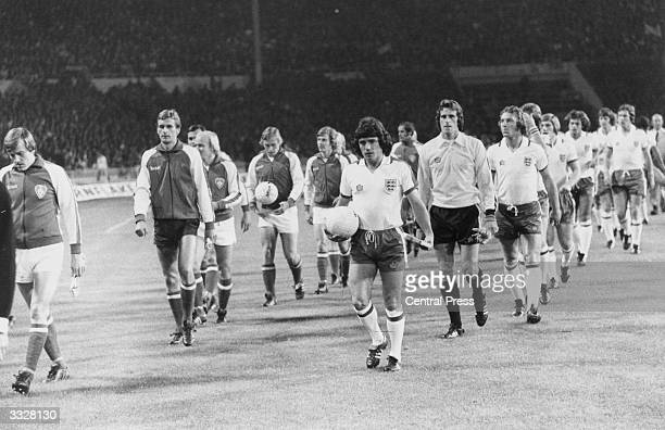 Kevin Keegan leads out the England Team for a World Cup Qualifying match at Wembley against Finland whose team is being led by Matti Paatledainen