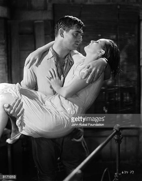 Dennis Carson played by Clark Gable finds romance on his rubber plantation with Barbara Willis played by Mary Astor in a scene from 'Red Dust'...