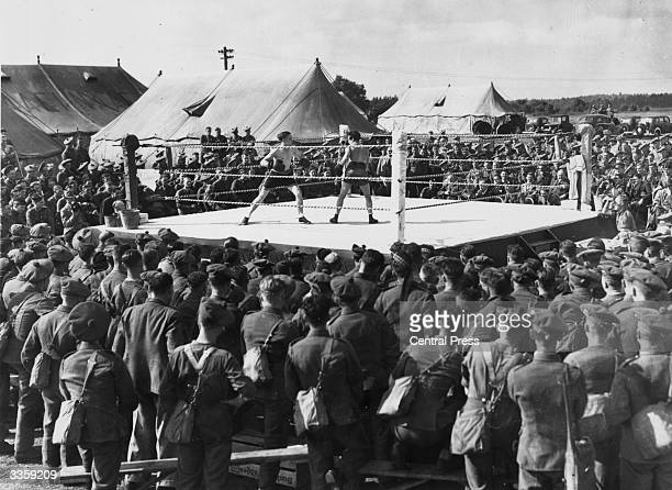 Championship boxers Dave Crowley and Harry Groves entertaining troops in Britain with exhibition contests