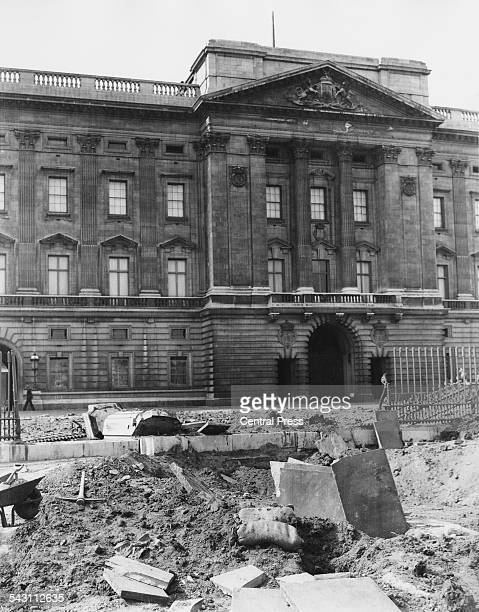 damaged railings outside Buckingham Palace London after the explosion of a German bomb dropped in an air raid the previous day