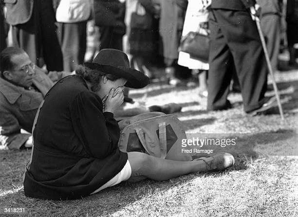 A woman crying during an anti fascist rally to honour the victims of wartime Nazi concentration camps at the WernerSeelenbinder Stadium Berlin