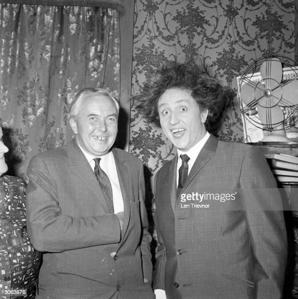 British prime minister Harold Wilson poses with Liverpudlian comedian Ken Dodd at the London Palladium