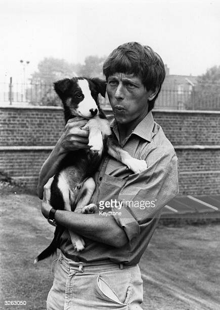John Noakes whistles to Shep his television pet from the children's show 'Blue Peter'