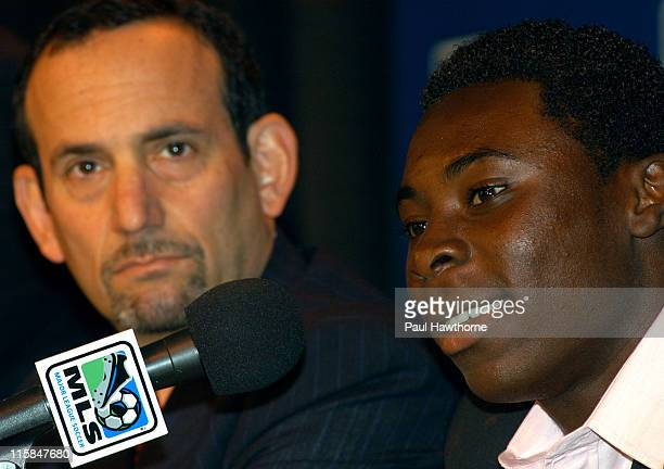 Year old Freddy Adu speaks as MLS Commissioner Don Garber looks on during a news conference announcing Adu's multi year deal with Major league Soccer...