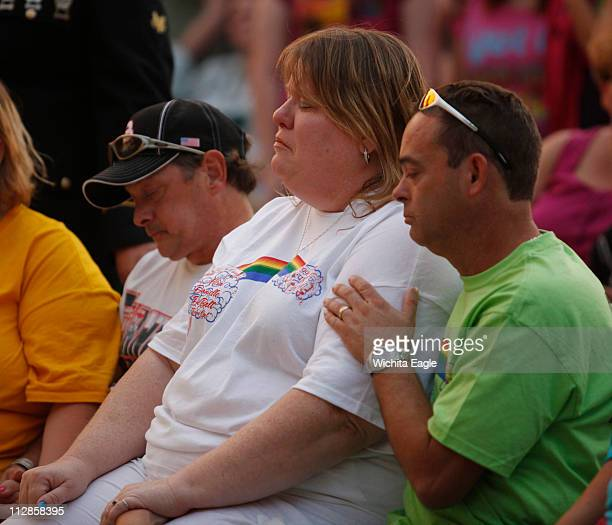 14yearold Alicia DeBolt's mother Tammy Conrad center is comforted by family members during prayer vigil in downtown Great Bend Kansas on Monday...