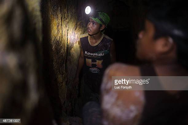 A 14yearold gold miner regards the tunnel walls skeptically If a tunnel does not regularly strike gold the owner will close the operation and the...