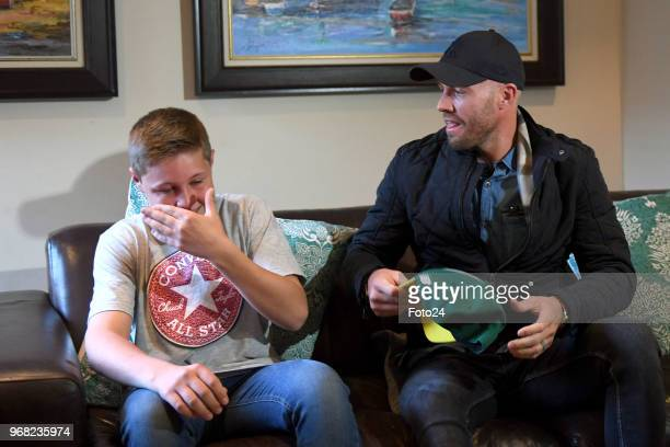 14yearold Leo Sadler meets his role model AB de Villiers at his home during an arranged surprise meeting on June 05 2018 in Pretoria South Africa The...